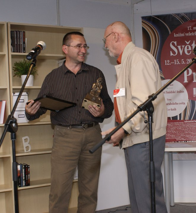 Petr Recieves the award on Behalf of Rob from František Novotný